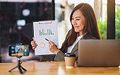 A businesswoman teaching business class , online meeting concept