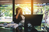 Businesswoman get stressed with screwed up papers and laptop on table while having a problem at work