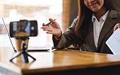 A young asian businesswoman teaching business class , online meeting concept