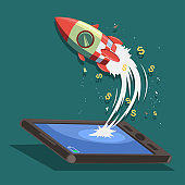 Startup vector concept design. Rocket ship flies from a smartphone or tablet. Vector cartoon illustration of a successful launch business.