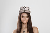 Dark beauty. Closeup portrait happy african american indian mixed race woman smiling slightly looking at you camera isolated white grey background. Crowned beauty queen, miss contestant bride to be