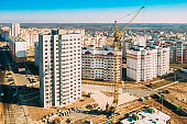 Gomel, Belarus. Construction Crane Is Involved In Construction Of A New Multi-storey Residential Houses. Aerial View Of Multistory Houses. Real Estate High-rise Buildings. Development Industry