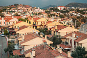 Beautiful Cityscape Of Turkish Town. White Residential Houses On Hillside. Real Estate Suburb In Summer Evening