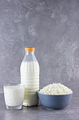 Various dairy products. Healthy dairy products on a gray background. Milk and cottage cheese. Copy space