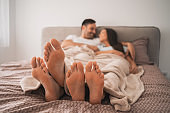 Couple resting in bed
