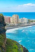 Hotels on a beach with black sand. Playa de Martianez, Puerto de la Cruz, Tenerife, Spain