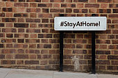 Stay at Home hashtag with a road banner