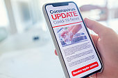 Close up of a mobile phone with Coronavirus covid-19 news update.