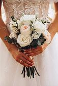 Bride holding wedding peonies bouquet