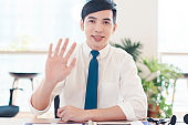 Head shot portrait confident young businessman  looking at camera and talking . business video conference concept