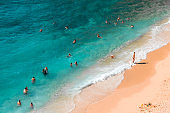 View of the turquoise beach. Beautiful Kaputas Beach (Turkey) with people resting under the sun and in the sea