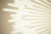 The shadow  from the rays on a white wall in sunny weather with bright light. Shadow overlay effect for photo.