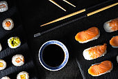 Healthy traditional japanese Sushi set nigiri and rolls with chopsticks.