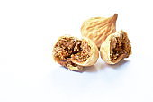 baked dry fig half cutting on white background