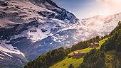 Barn farms and Snowcapped Monte Cevedale Palon de la Mare, Ortler massif  – Lombardy, Italian alps