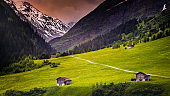 Barns for hay and farms in alpine landscape at springtime - Val d'Isère, Vanoise – French alps