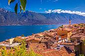 Yachts and sailboats on Lake Garda and Trentino alps above Limone, Italy
