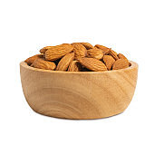 Almond in wooden cup isolated on white background with clipping path.
