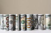 Rolls of US dollar bill in a row