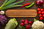 Healthy food. Raw organic vegetables and fruits. On wooden background. Top view. Copy space.
