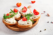 Healthy and tasty snack with bread, tomatoes and cottage cheese