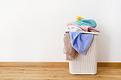 Laundry basket with dirty towels