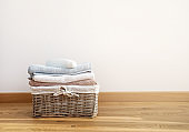 Wicker laundry basket with clean bath towels