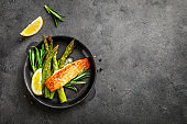 Delicious lunch, baked salmon with asparagus