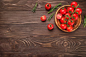 Red ripe cherry tomatoes on wooden table