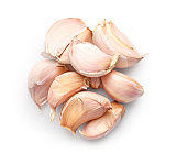 Pile of garlic cloves isolated on white background. Top view