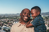 Grandfather and grandson with cityscape background