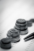 Close-up Coins and Pen on Financial Report