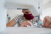 Close up of Asian woman sewing a pollution mask