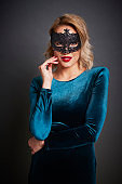 Beautiful woman with masquerade mask  in studio shot