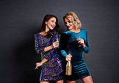 Happy women toasting to good new year