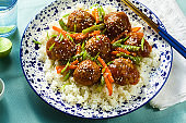 meatless vegan Asian meatballs in sweet and sour sauce with rice and stewed vegetables. balanced lunch or healthy dinner. street food