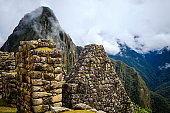 Sunshine view of Machupicchu stone anchient walls and temple among mountains