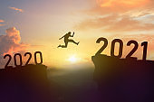 Man jump 2020 to 2021 new year