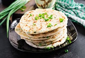 Traditional indian bread. Pita bread with green onions. Onion naan.