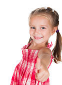 Smiling little girl does thumb up