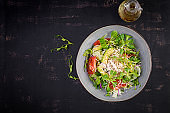 Fresh salad with chicken breast, corn salad, cucumber, avocado and tomato. Chicken salad. Italian cuisine. Healthy food concept. Top view, overhead