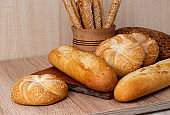 Crisp bread with buns. French baguettes. Fresh crispbread. Bread background. Different breed  on wooden background.