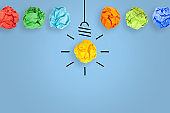 Idea Concepts with Light Bulb Crumpled Paper on Blue Background