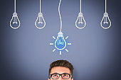 Creative idea concepts with light bulbs on touch screen