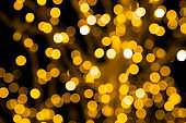 Unfocused christmas lights. Festive bokeh lights background.
