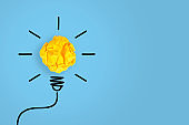 Idea Concepts Light Bulb Crumpled Yellow Paper on Yellow Background