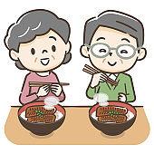 Illustration of an elderly couple eating eel
