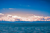 Sunset on Issyk-kol lake, Kyrgyzstan. Lake in the mountains. Lake with mountains background.