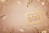 Happy New Year celebration card with golden numbers 2021 and Christmas decorations.
