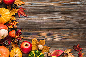 Thanksgiving, Halloween or autumn background. Fall composition on rustic wooden table. Flat lay, top view